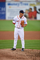 Salem Red Sox relief pitcher Jared Oliver (15) looks in for the sign during the first game of a doubleheader against the Potomac Nationals on June 11, 2018 at Haley Toyota Field in Salem, Virginia.  Potomac defeated Salem 9-4.  (Mike Janes/Four Seam Images)