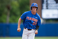 JJ Schwarz (22) of the Florida Gators hustles towards third base against the Wake Forest Demon Deacons in Game Three of the Gainesville Super Regional of the 2017 College World Series at Alfred McKethan Stadium at Perry Field on June 12, 2017 in Gainesville, Florida. The Gators defeated the Demon Deacons 3-0 to advance to the College World Series in Omaha, Nebraska. (Brian Westerholt/Four Seam Images)