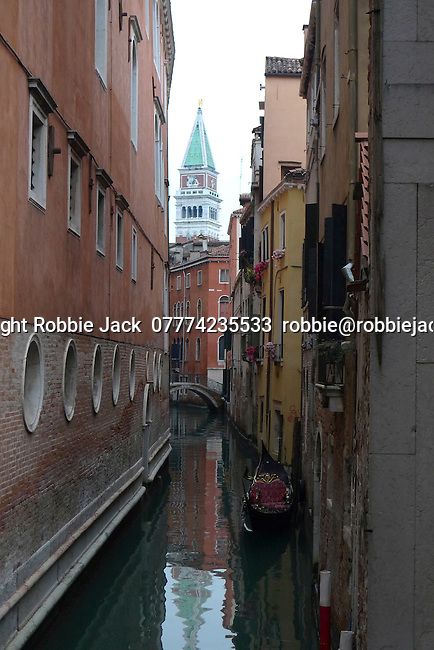 Gondola on canal in Venice, Italy.