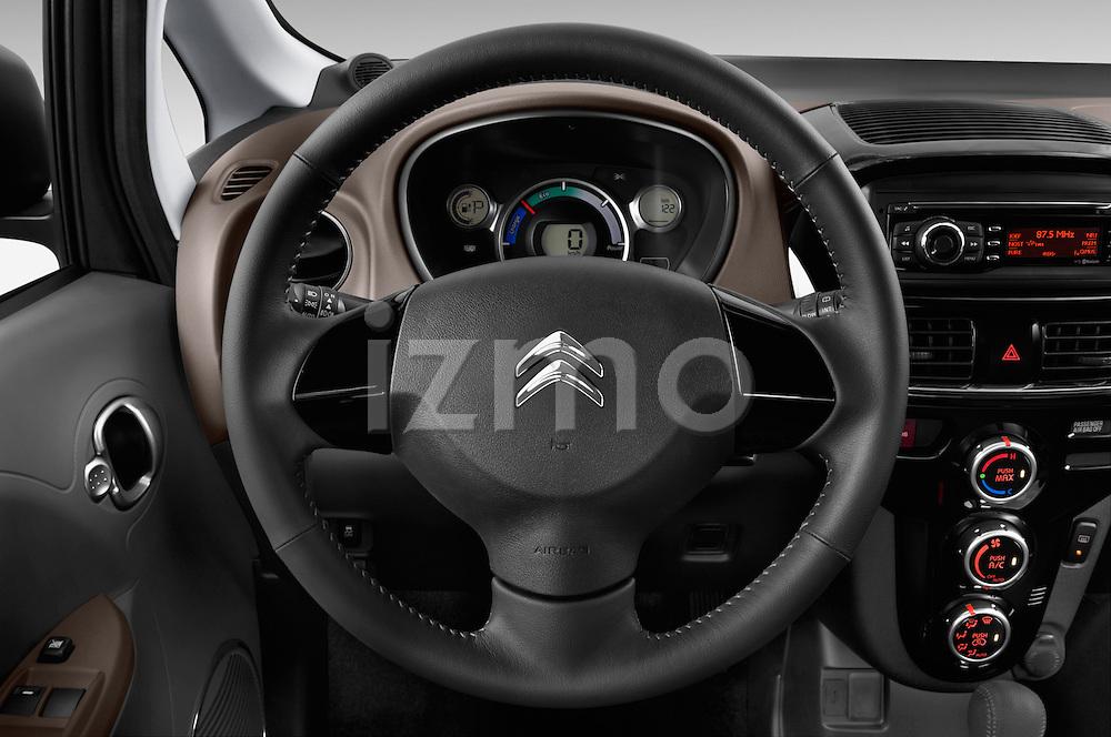 Car pictures of steering wheel view of a 2016 Citroen C-Zero Confort 5 Door Micro Car Steering Wheel