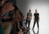 """Gli stilisti di Comeforbreakfast Antonio Romano e Francesco Alagna, a destra, finalisti del progetto """"Who is on next?"""", durante la rassegna Altaroma a Roma, 8 Luglio 2013..<br /> Comeforbreakfast 's designers Antonio Romano and Francesco Alagna, right, finalists of """"Who is on next?"""" project, on the catwalk during the Altaroma fashion week in Rome, 8 Luglio 2013.<br /> UPDATE IMAGES PRESS/Virginia Farneti"""