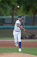 AZL Dodgers third baseman Leonel Valera (23) throws to first base during an Arizona League game against the AZL White Sox at Camelback Ranch on July 3, 2018 in Glendale, Arizona. The AZL Dodgers defeated the AZL White Sox by a score of 10-5. (Zachary Lucy/Four Seam Images)