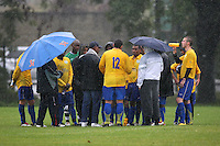 Clapton Rangers FC hold their half-time team talk in pouring rain during a Hackney & Leyton Sunday League match at Hackney Marshes - 05/10/08 - MANDATORY CREDIT: Gavin Ellis/TGSPHOTO - Self billing applies where appropriate - Tel: 0845 094 6026