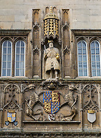 UK, England, Cambridge.  Statue of Henry VIII, founder of Trinity College, 1546.  Coat of arms of Edward III below the statue.