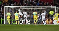 Swansea, UK. Thursday 20 February 2014<br /> Pictured: Wilfried Bony of Swansea (3rd L) fails to score with a header<br /> Re: UEFA Europa League, Swansea City FC v SSC Napoli at the Liberty Stadium, south Wales, UK