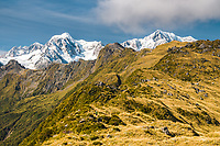 Mount Tasman 3497m left, Mount Cook 3754m right with tiny hiker in foreground, as seen from Mount Fox, Westland National Park, West Coast, World Heritage Area, New Zealand