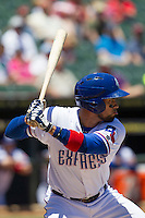 Round Rock designated hitter Robinson Chirinos (14) at bat against the Nashville Sounds in the Pacific Coast League baseball game on May 5, 2013 at the Dell Diamond in Round Rock, Texas. Round Rock defeated Nashville 5-1. (Andrew Woolley/Four Seam Images).