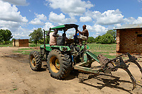 ZAMBIA, Mazabuka, Chikankata area, medium scale farmer Stephen Chinyama, homestead with John Deere tractor