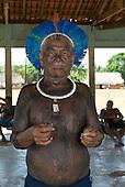 Pará State, Brazil. Aldeia Kikretum. Tumré Kayapó, wearing a blue macaw feather cokaa headdress.