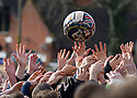"""17/02/15  <br /> <br /> Players reach for the ball at the annual Royal Shrovetide Football  Match in Ashbourne, Derbyshire. After 'turning up' the ball at 2pm thousands of rival Up'Ards' and Down'Ards' team members attempt to 'goal' the ball onto stones set three miles apart in the town of Ashbourne, Derbyshire. The game also known as """"hugball"""" has been played from at least c.1667 although the exact origins of the game are unknown but one of the most popular origin theories suggests the macabre notion that the 'ball' was originally a severed head tossed into the waiting crowd following an execution.<br /> <br /> <br /> All Rights Reserved - F Stop Press.  www.fstoppress.com. Tel: +44 (0)1335 418629 +44(0)7765 242650"""