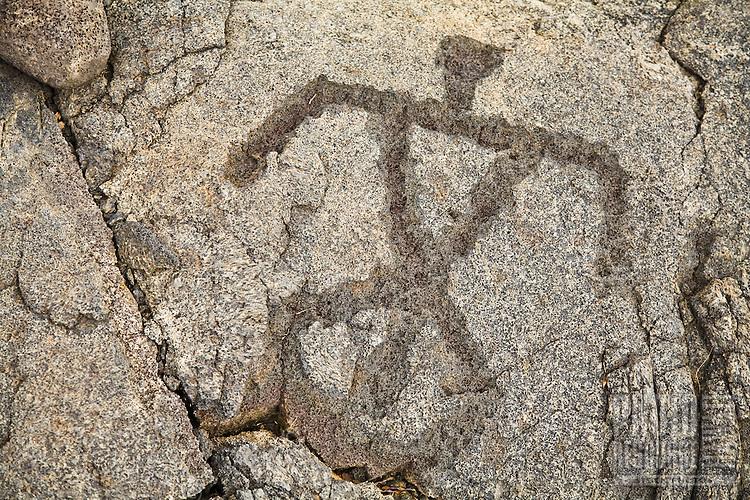 Petroglyph on a rock of a man - Puuloa, Big Island of Hawaii