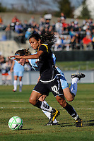 Marta Vieira da Silva (10) of the Los Angeles Sol beats Keeley Dowling (17) of Sky Blue FC as she scores her first goal. The Los Angeles Sol defeated Sky Blue FC 2-0 during a Women's Professional Soccer match at TD Bank Ballpark in Bridgewater, NJ, on April 5, 2009. Photo by Howard C. Smith/isiphotos.com