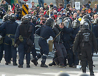 OTTAWA , November 17th 2001 FILE PHOTO<br /> <br /> A protester is dragged inside the security perimeter after beeing  arrested by Policemen in riot gear during a demonstration against the meeting of the G-20 , while demonstrators gathers on the other side of the barricades, in Ottawa CANADA  on Saturday, November 17, 2001.<br /> <br />  Police  used tear gas, concussion grenade's and pepper spray in their attempt to repel the protestor's from entering the security perimeter.<br /> <br /> The  G-20 meeting , where central bank chiefs and finance ministers from rich and poor nations discuss topics such as ; terrorism funding, economy slowdown and 3rd world nation's debt was initially scheduled for september in India,but  postponed  to  November 16th to 18th, 2001 and is beeing hosted by G-20 Chair ;  Canada Minister of Finance ;  Paul Martin.