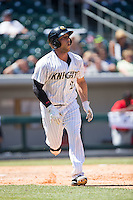 George Kottaras (20) of the Charlotte Knights starts down the first base line as he watches the flight of his second home run of the game against the Indianapolis Indians at BB&T BallPark on June 21, 2015 in Charlotte, North Carolina.  The Knights defeated the Indians 13-1.  (Brian Westerholt/Four Seam Images)