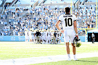 CHAPEL HILL, NC - NOVEMBER 14: Sam Hartman #10 of Wake Forest watches a defensive huddle from the sideline during a game between Wake Forest and North Carolina at Kenan Memorial Stadium on November 14, 2020 in Chapel Hill, North Carolina.
