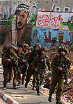 An Israeli soldiers take position during the clashes at the Qalandia checkpoint between the West Bank city of Ramallah and Jerusalem on March 17, 2010. Israel on Wednesday lifted its tight restrictions on Palestinian access to Jerusalem's holiest shrine and called off an extended West Bank closure after days of clashes between Palestinians and Israeli security forces. While there were no reports of new clashes in Jerusalem, sporadic violence broke out Wednesday in the West Bank. Photo by Issam Rimawi