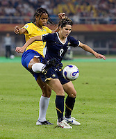 Brazil midfielder (5) Renata Costa tries to get a foot around Australia forward (9) Sarah Walsh during the quarterfinals of the FIFA Women's World Cup at Tianjin Olympic Center Stadium in Tianjin, China.  Brazil defeated Australia, 3-2.