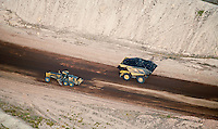 aerial photograph of Catepillar 777D truck loaded with coal and 16M grader working coal mine southern Wyoming