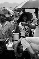Debt bondage in Alcohol and sugar Plant. Sugarcane cutters in line for lunch. Contemporary slavery, unhealthy facililities and conditions of work and living, Northeastern Brazil.
