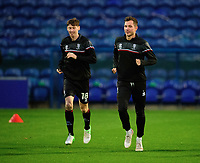 Lincoln City's Conor McGrandles, left, with team-mate Tom Hopper during the pre-match warm-up<br /> <br /> Photographer Andrew Vaughan/CameraSport<br /> <br /> EFL Trophy Northern Section Group E - Mansfield Town v Lincoln City - Tuesday 6th October 2020 - Field Mill - Mansfield  <br />  <br /> World Copyright © 2020 CameraSport. All rights reserved. 43 Linden Ave. Countesthorpe. Leicester. England. LE8 5PG - Tel: +44 (0) 116 277 4147 - admin@camerasport.com - www.camerasport.com