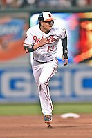 Baltimore Orioles third baseman Manny Machado #13 runs to third during a game against the New York Yankees at Oriole Park at Camden Yards August 11, 2014 in Baltimore, Maryland. The Orioles defeated the Yankees 11-3. (Tony Farlow/Four Seam Images)