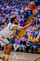 12 March 2019: University of Vermont Catamount Forward Anthony Lamb, a Junior from Toronto, Ontario, keeps the ball in play during game action against the Binghamton University Bearcats at Patrick Gymnasium in Burlington, Vermont. Lamb finished the game with 18 points and a career-high seven assists as the top-seeded Catamounts advanced to their fourth-straight America East conference championship game, defeating the Bearcats 84-51. Mandatory Credit: Ed Wolfstein Photo *** RAW (NEF) Image File Available ***