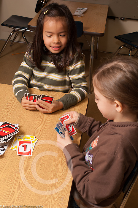 Public elementary school Grade 2 two girls playing UNO card game during choice period