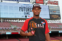 World Team pitcher Jarlin Garcia (33) poses for a photo during practice before the MLB All-Star Futures Game on July 12, 2015 at Great American Ball Park in Cincinnati, Ohio.  (Mike Janes/Four Seam Images)