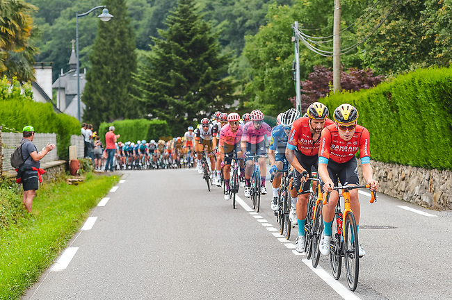 The peloton led by Bahrain Victorious during Stage 18 of the 2021 Tour de France, running 129.7km from Pau to Luz Ardiden, France. 15th July 2021.  <br /> Picture: A.S.O./Charly Lopez | Cyclefile<br /> <br /> All photos usage must carry mandatory copyright credit (© Cyclefile | A.S.O./Charly Lopez)