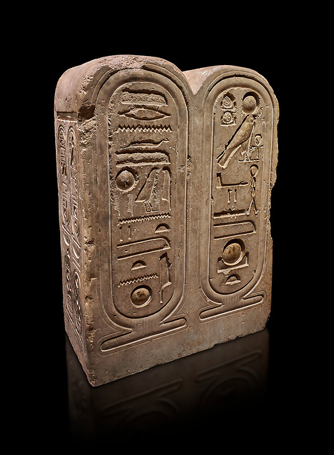 "Ancient Egyptian architectonic element of the temple of Aten, Karnak, limestone, New Kingdom 18th Dynasty (1353-1336 BC). Egyptian Museum, Turin. black background<br /> <br /> This crystaline block from the riugn of Amenhoptep IV was part of the railing of the temple of Aten in Karnak. It is os a double form cartouche, which usually enclose the name of the king. Here insted, it contains the names of the sun disk Aten, the one god of King Akhenaten : ""Ra-Harakhty rising in the Horizon"" ""in the name as the light which is in Aten"". The name of the king is carved on the sides. The objects is therefore a links god with the pharoah. Drovetti collection Cat 1378"
