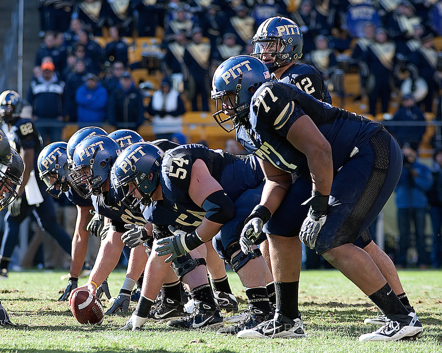 The Pitt offense lines up for a play. The WVU Mountaineers defeated the Pitt Panthers 35-10 at Heinz Field, Pittsburgh, Pennsylvania on November 26, 2010.
