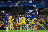 Goalkeeper Predrag Rajkovic of Maccabi Tel Aviv punches clear of Chelsea Captain Gary Cahill during the UEFA Champions League match between Chelsea and Maccabi Tel Aviv at Stamford Bridge, London, England on 16 September 2015. Photo by Andy Rowland.