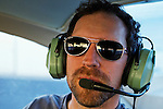 Mountain Lion (Puma concolor) biologist, Paul Houghtaling, tracking mountain lions from airplane using telemtry, Santa Cruz Puma Project, Livermore, California