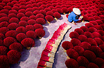 Brightly coloured incense stick laid out to dry by Tran Tuan Viet
