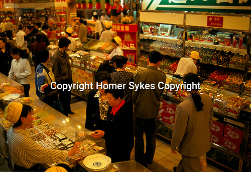 Beijing China 1990s. Wealthy new money rich middle professional class shopping in a department store 1998.