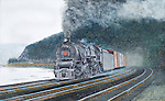"""A Pennsylvania Railroad M1 steam locomotive powered freight train pounding the PRR mainline trackage along the Susquehanna River above Harrisburg. Oil on canvas, 10"""" x 16""""."""
