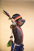 An indigenous boy watches the competition during the International Indigenous Games, in the city of Palmas, Tocantins State, Brazil. Photo © Sue Cunningham, pictures@scphotographic.com 26th October 2015