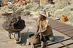 Poor Mexican man labors to create a brick platform<br /> (1)