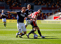 17th April 2021; Brentford Community Stadium, London, England; English Football League Championship Football, Brentford FC versus Millwall; Marcus Forss of Brentford is challenged by George Evans of Millwall