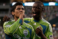 Fredy Montero (l) and Steve Zakuani (r) celebrate Montero's goal in the Seattle Sounders 2-1 win against San Jose Earthquake on Saturday, June 13, 2009 at Quest Field in Seattle, WA.