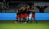 WASHINGTON, DC - MAY 13: Edison Flores #10 of D.C. United celebrates his score with teammates during a game between Chicago Fire FC and D.C. United at Audi FIeld on May 13, 2021 in Washington, DC.