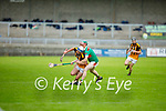 Abbeydorney's Jack Sheehan been tightly marked by Crotta's Sean Weir in the round 2 game of the County Senior hurling championship