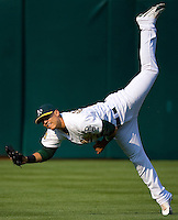 OAKLAND, CA - JULY 12:  Carlos Gonzalez of the Oakland Athletics makes a throw from center field during the game against the Los Angeles Angels of Anaheim at the McAfee Coliseum in Oakland, California on July 12, 2008.  The Angels defeated the Athletics 4-1.  Photo by Brad Mangin