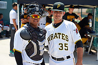 GCL Pirates catcher Gabriel Brito and Angel Vasquez (35) before a game against the GCL Braves on July 26, 2017 at Pirate City in Bradenton, Florida.  GCL Braves defeated the GCL Pirates 12-5.  (Mike Janes/Four Seam Images)
