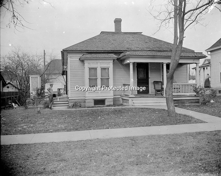 JOHNSON HOUSE, 1310 A STREET. James Trusty, a carpenter and African American Civil War veteran, built this house in 1891 for Harrison Johnson (1849-1900). During the Civil War, Johnson, an Arkansas native, escaped from slavery and took refuge with Nebraska's 1st Regiment. He enlisted as a private and served out the war with the all-white regiment. After the war he settled in Lincoln. He was a member of the Farragut Post of the Grand Army of the Republic and worked as a hotel cook and janitor. Harrison and his wife, Margaret, had one son, John<br /> <br /> Photographs taken on black and white glass negatives by African American photographer(s) John Johnson and Earl McWilliams from 1910 to 1925 in Lincoln, Nebraska. Douglas Keister has 280 5x7 glass negatives taken by these photographers. Larger scans available on request.