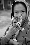 A Greenlandic girl and her kitten. Cape Farewell Youth Expedition 08(©Robert vanWaarden ALL RIGHTS RESERVED)