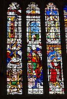 UK, England, Cambridge.  King's College Chapel, Stained Glass Window showing the Circumcision of Jesus.  Note the eyeglasses being work by the surgeon.