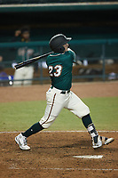 Grant Koch (23) of the Greensboro Grasshoppers follows through on his swing against the Hickory Crawdads at First National Bank Field on May 6, 2021 in Greensboro, North Carolina. (Brian Westerholt/Four Seam Images)