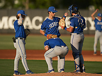 Jesuit Tigers Nick Rodriguez (33), Alden Segui (16), Tyler Corish (14), and Cole Russo (22) during a game against the IMG Academy Ascenders on April 21, 2021 at IMG Academy in Bradenton, Florida.  (Mike Janes/Four Seam Images)