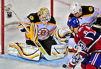 22 April 2009: Boston Bruins' goaltender Tim Thomas makes one of his 26 saves for the night during third period action against the Montreal Canadiens at the Bell Centre in Montreal, Quebec, Canada. The Bruins advance to the Eastern Semi-Finals, eliminating the Canadiens from Stanley Cup competition with their 4-1 win and series sweep. ***** Editorial Sales Only ***** Mandatory Credit: Ed Wolfstein Photo